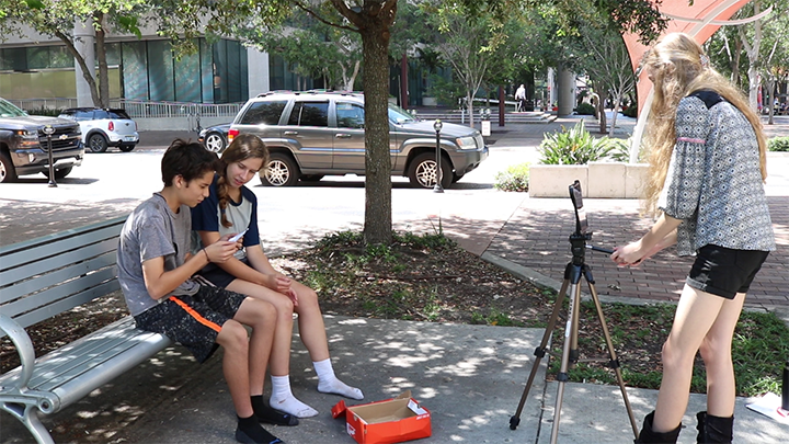 Students film outside the Tampa Theatre during summer film camp