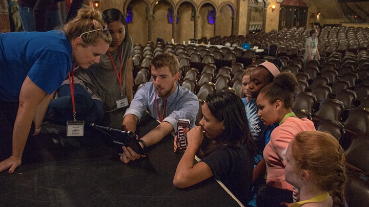 Camp director Nate Wolkenhauer and other camp counselors help students plan out a shot for their film