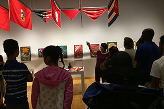 Students are guided through an art exhibit at the USF Contemporary Art Museum