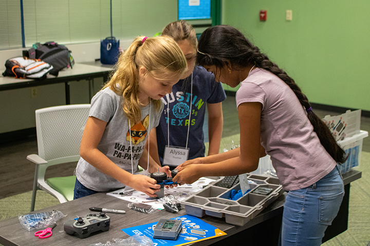 Girls working with VEX IQ robot at USF Robotics Summer Camp