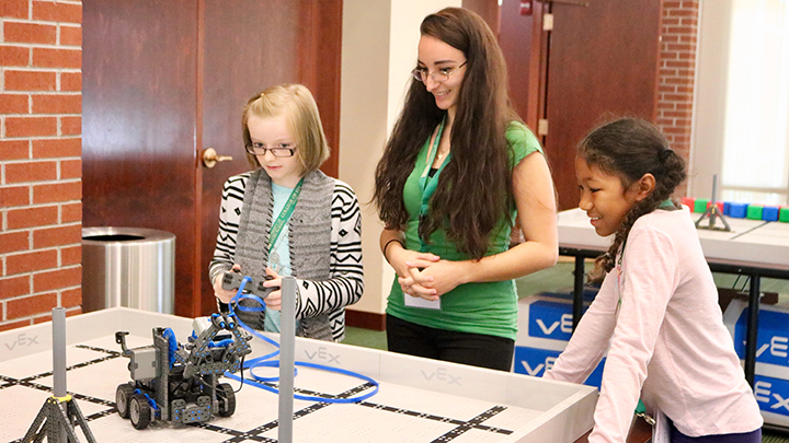 Students work with USF mentor at Robotics practice field