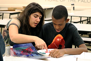 USF Student Teacher with Pepin Academies Student in Art Class