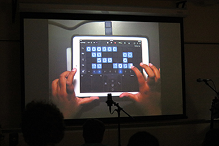 Student presenting iPad music creation at closing showcase