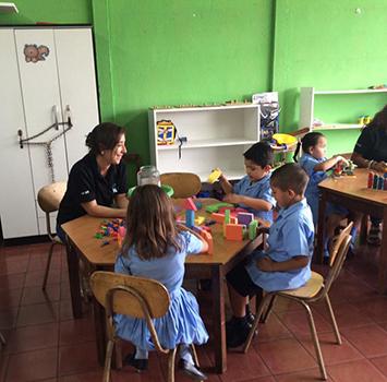 Teacher teaching student in Costa Rica