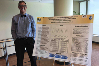 Andrew Apugliese in front of poster