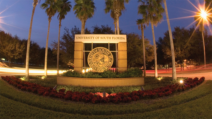 USF entrance with seal at night