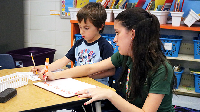 Student working with 2nd grader during the elementary education field placement.