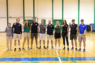 USF students pose for a photo in a gym on USF's Tampa campus