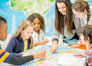 teacher shares world map with students