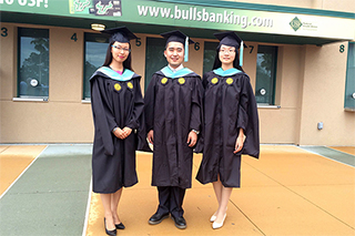 Photo of three Minzu students in their graduation cap & gowns