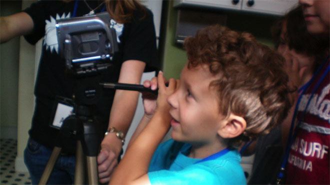 Child recording footage with a video camera