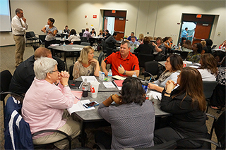 Photo of attendees' discussion at a round table
