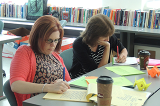 Two instructors working on a writing project
