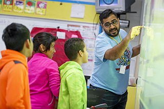 Teacher-leader Yobanec Reyes engages his students in a math lesson.
