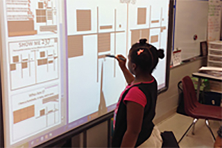 student working with interactive promethean whiteboard
