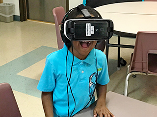 Elementary grade student uses a virtual reality headset