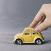 Toy car pushed by hand