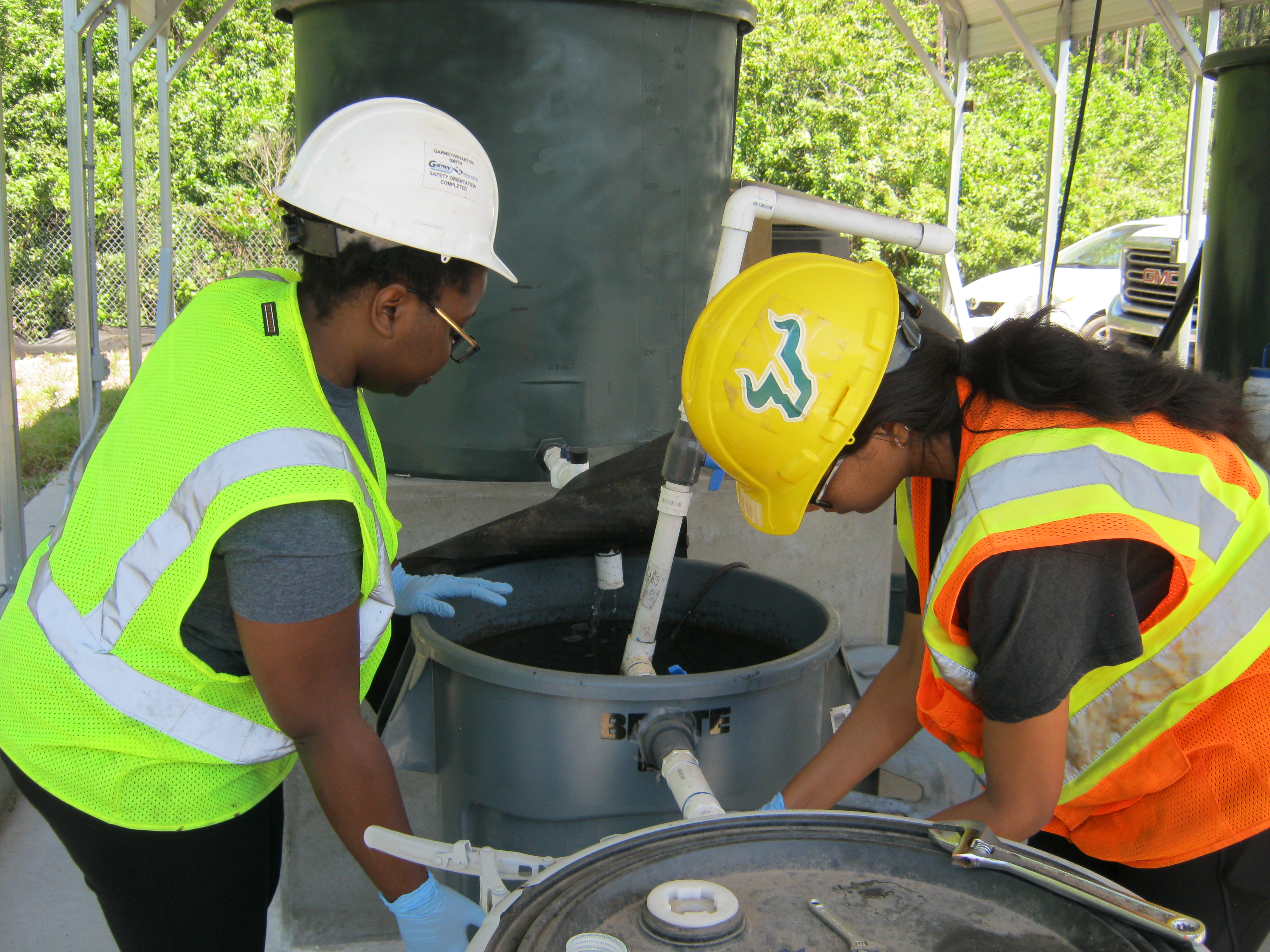 Students and faculty work on a CEE wastewater treatment site
