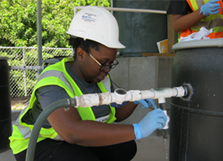 CEE students and faculty work on a project at a test wastewater facility