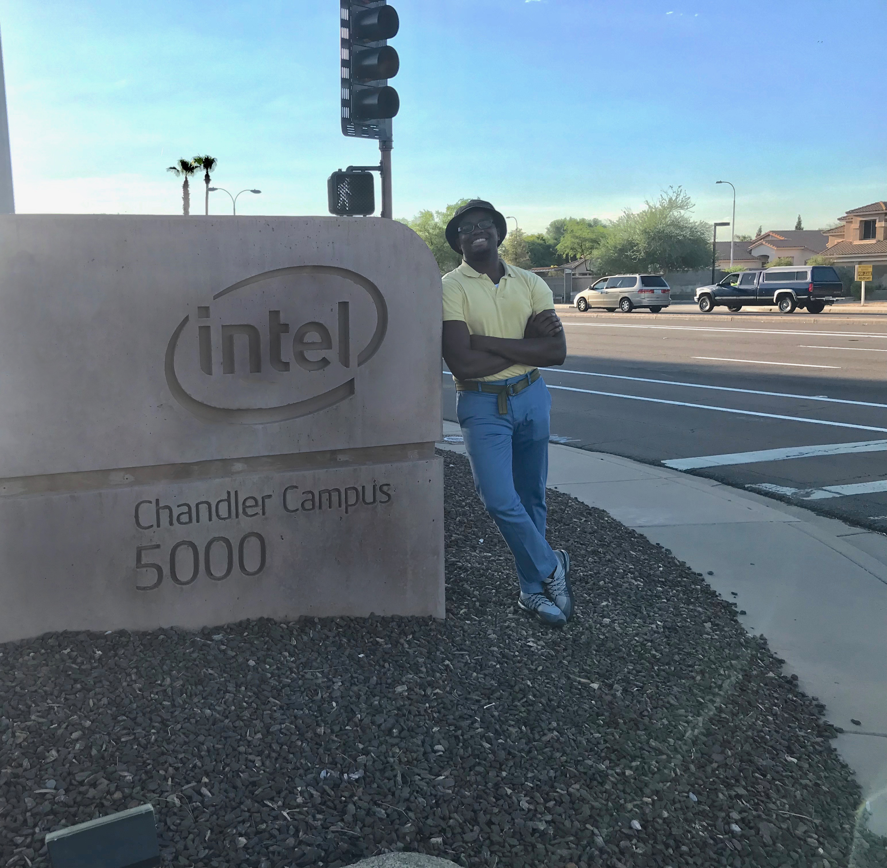 Ossie Douglas stands in front of Intel's Chandler campus sign