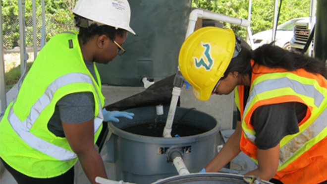 CEE HABiTS students and faculty work at a test wastewater treatment site as part of an award-winning department project