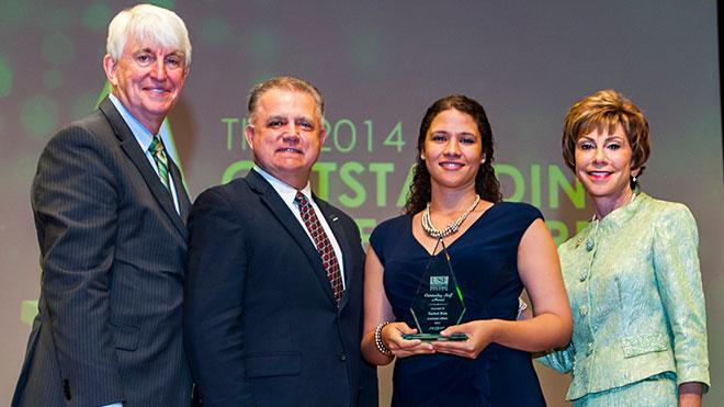 Picture of Yaricet Ruiz receiving the USF Outstanding Staff Award