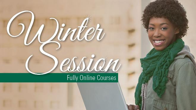 Female wearing a coat and scarf on a computer with the words Winter Session Fully Online Courses.