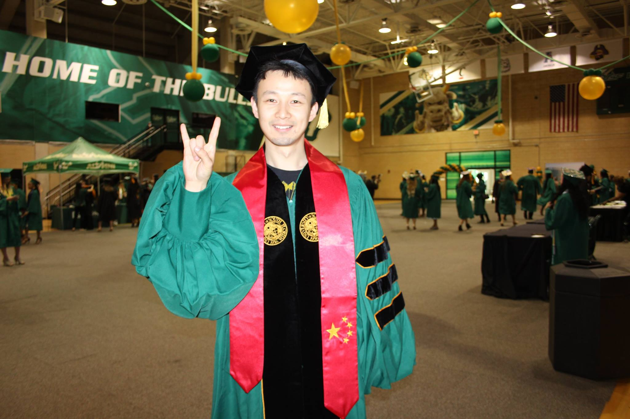 After five years at the University of South Florida, Xu Zhang, a Doctor of Medicine from China, graduates with his PhD in Molecular Pharmacology.n