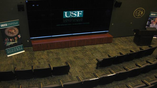 Empty lecture hall with USF displayed on a big projector.