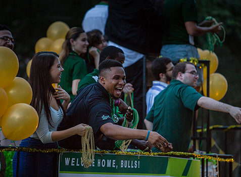 Rocky the Bull, President Steven Currall, and Dr. Cheyenne Currall at the 2019 Homecoming Parade