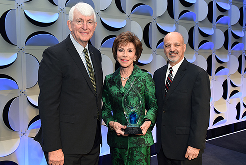 Photo of President Judy Genshaft, Provost Ralph Wilcox and Vice President for Student Success Paul Dosal recieving the ACE/Fidelity Investments Award