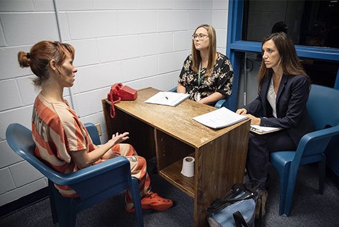 USF student and researcher interviewing a jail inmate