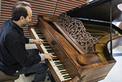 Pianist playing USF's newly acquired 1861 Steinway piano.