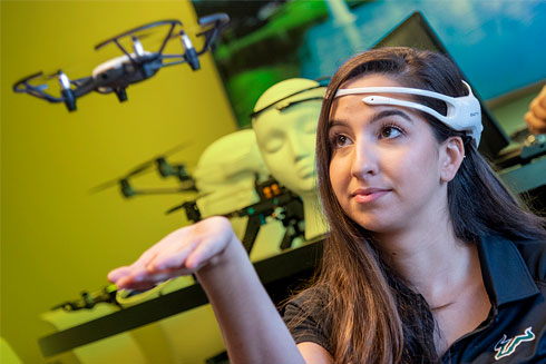 Sarah Garcia, a PhD student in Dr. Marvin Andujar's Neuro-Machine Interaction Lab, controls a drone with her mind.