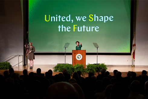 President Genshaft standing at a podium during her fall address