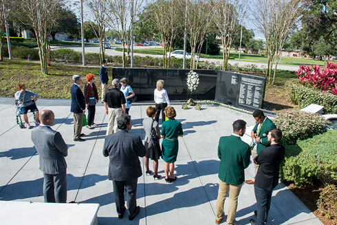 People gather around the USF Student Memorial on USF Tampa campus