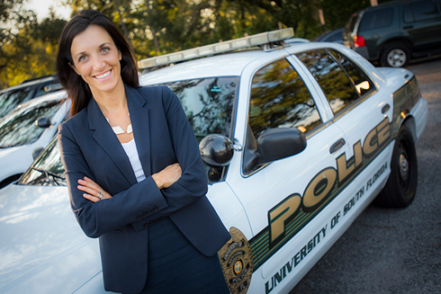 Dr. Bryanna Fox in front of a USF police car.