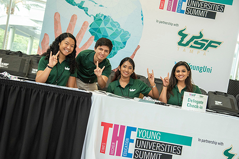 USF students helping check-in delegates at the Young Universities Summit.