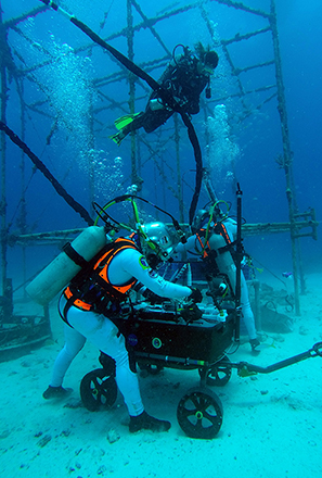 divers during a research mission for NASA