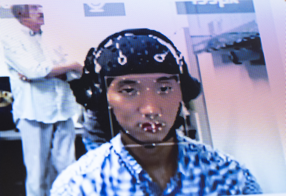 A research participant wearing a brain wave monitoring device