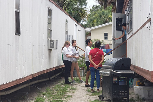 Anna Wright, Allan Avendano and Ryan Charles conducting outreach in Wimauma, Fla.