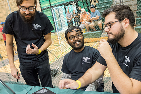 USF graduate students working at the 2019 USF Drone Race