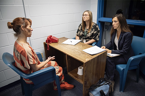 A USF sudent and faculty interview a femail inmate inside the Pasco County Detention Facility