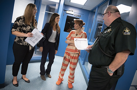 USF student and faculty researcher with a female inmate participant and Lieutenant Warren Jones at the Pasco County Detention Facility