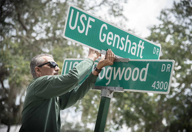 USF Facilities Management installs new USF Genshaft Drive signs along former Maple Drive