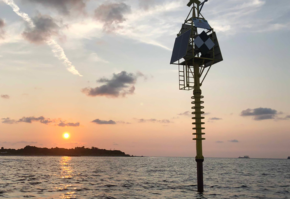 The patent-pending seafloor geodesy system is an anchored spar buoy topped by high precision Global Positioning System (GPS).