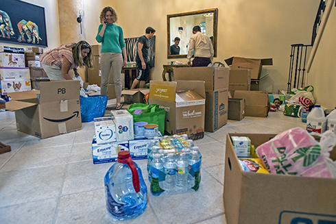 Asa Oxner, MD, assistant professor of medicine and vice chair for the Department of Internal Medicine in the USF Health Morsani College of Medicine collecting items for Bahamas