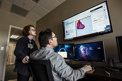 Dr. Summer Decker and Dr. Jonathan Ford make a 3D model of a heart in USF Health's Department of Radiology in USF Health South Tampa Center for Advanced Healthcare in downtown Tampa. Dr. Decker, the director of imaging research, and Dr. Ford, a biomedical engineer for imaging research, have been at the forefront of USF Health Radiology's department trailblazing use of 3D modeling in clinical capacities.