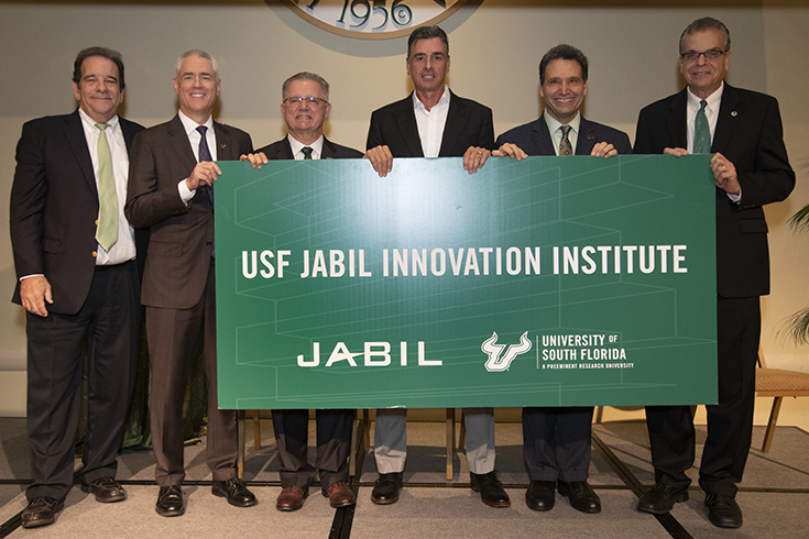 USF administrators with the Jabil CEO