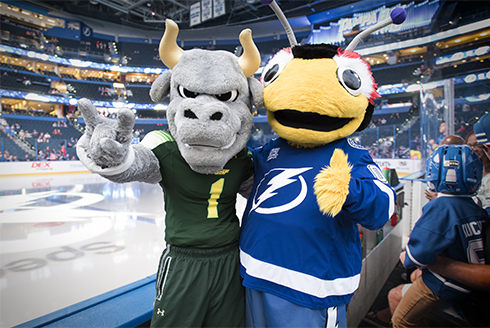 Thunderbug and Rocky pose for a picture at Amalie Arena